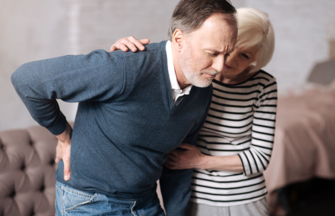 older man with hurt back from fall